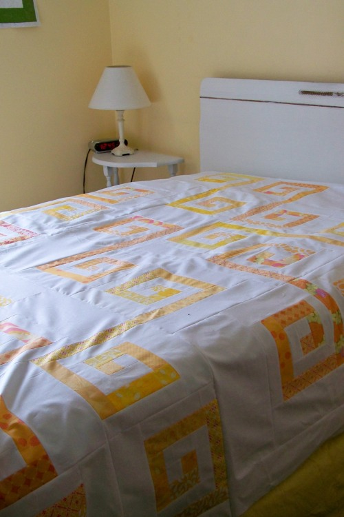 modern quilt - pink and yellow spiral pattern